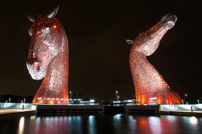 Kelpies glow red in this night time shot.