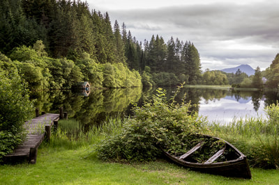 A small boat and jetty at Loch Ard, one of the many beautiful lochs from Aberfoyle to Inversnais.