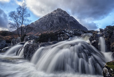 One of the many waterfalls along the river Etive with the Buachaille in the background.