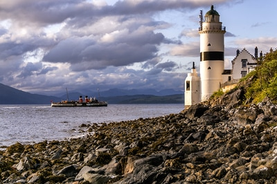 Waverley paddle steamer sails past the cloch lighthouse.