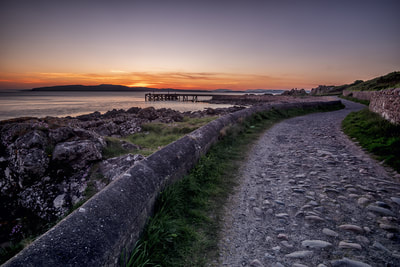 Rustic path leading to Portencross jetty.